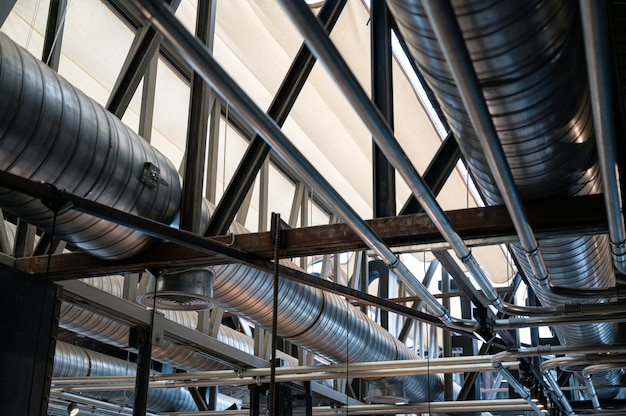 Ceiling structure with steel ventilation pipe and shiny pipe systems