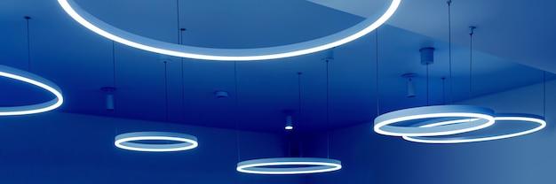 丸いモダンなledランプで天井天井の下に吊り下げられた蛍光灯