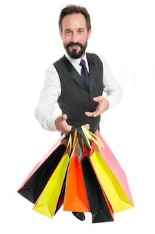 Celebrate corporate anniversary. system bonus benefits. corporate gift for regular customer. man bearded businessman formal wear holds bunch gift packages white background. banking bonus benefits.