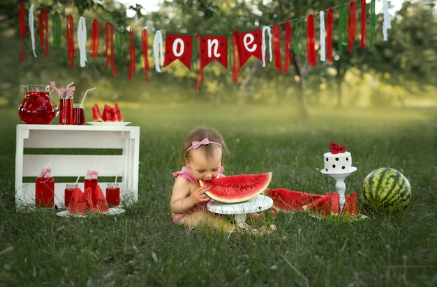 Celebrating a childs first birthday in nature with a cake and watermelons