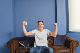 Celebrating football fan on couch