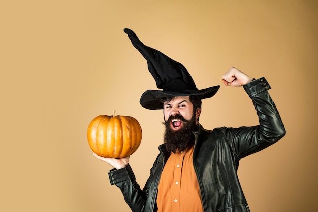 Celebrating happy thanksgiving day thanksgiving day cooking halloween man posing with pumpkins happy...