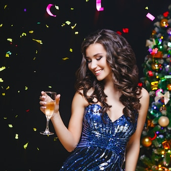 Celebrating Woman. Holiday People. Beautiful Girl with perfect Makeup Holding Glass of Champagne