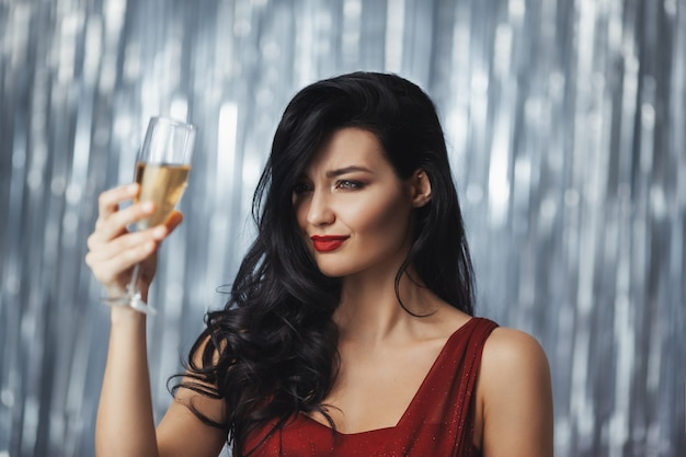 Celebrating woman in red dress