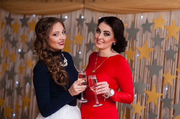 Celebration. beautiful girls are drinking champagne.