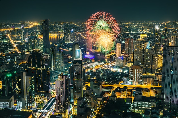 Celebration fireworks in holiday at night time in the business city bangkok thailand