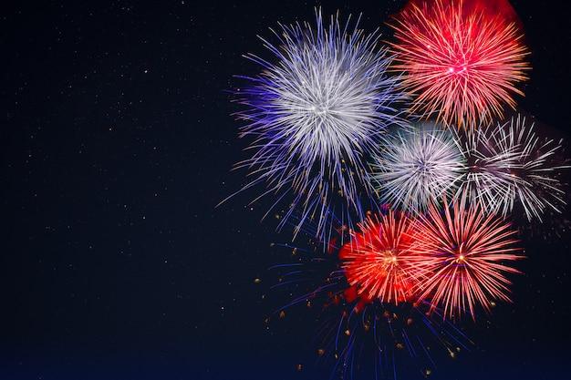 Celebration fireworks over night sky, copy space
