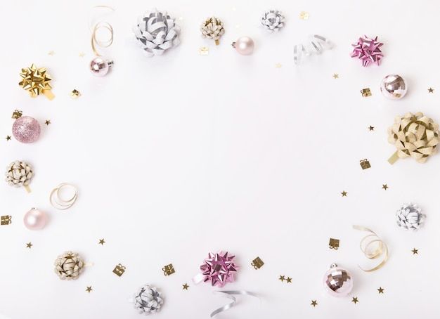 Celebration, party backgrounds concepts ideas with golden, silver and pink colorful gift bow, confetti, streamers. birthday, new year, christmas concept. overhead top view, flat lay. copy space.