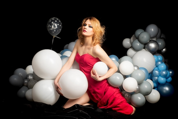 Celebration party sensual woman with balloons. holidays present gift.