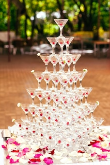 Celebration. pyramid of champagne glasses.