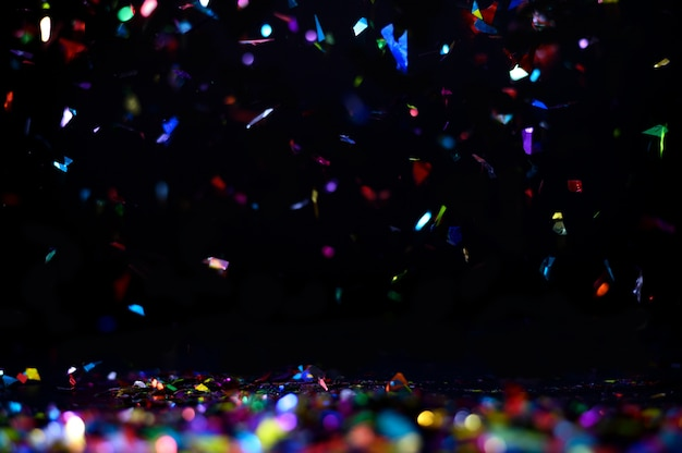 Celebration with colorful confetti flying , isolated on back background
