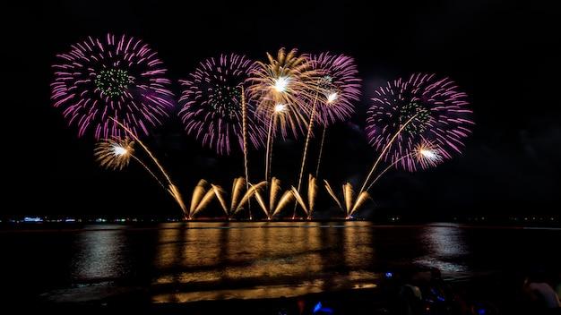 Celebrations firework at night on the sea pattaya city thailand