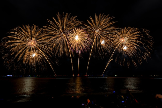 Celebrations firework at night on the sea pattaya city thailand