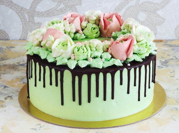 Celebratory cake with roses made of cream