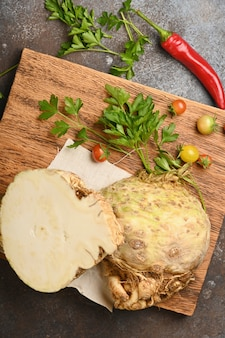Celery root on wooden cutting board