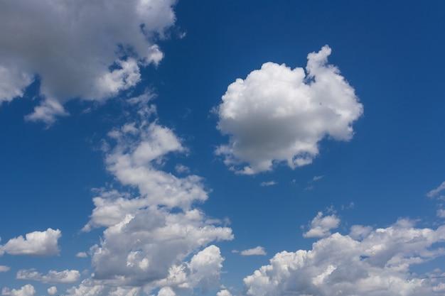 Celestial landscape with large cumulus clouds in a blue sky