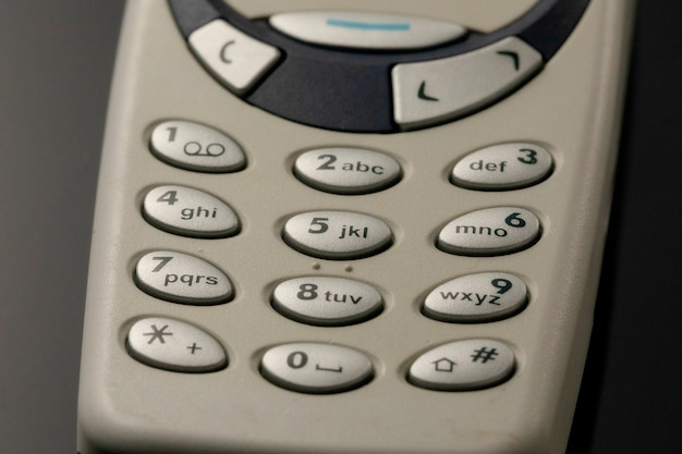 Cell phone pads. buttons of old phone close-up