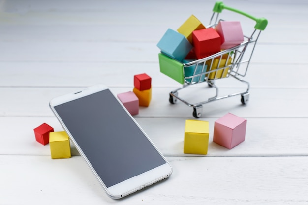 Cell phone and shopping cart , online shopping , mobile shopping concept
