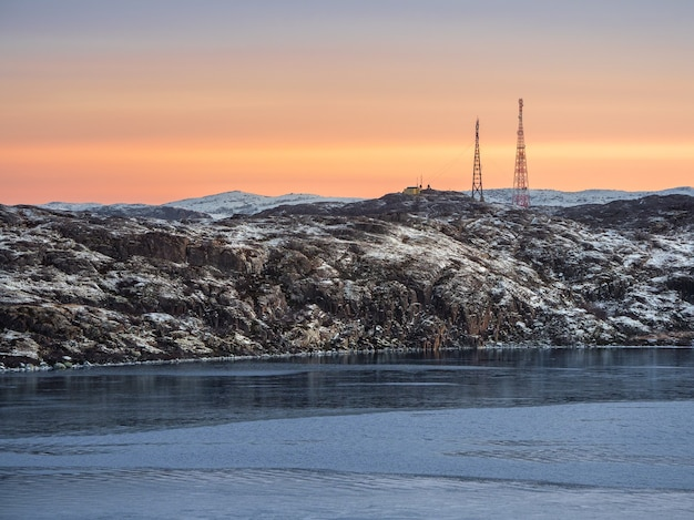 Cell towers in the snow-covered hills in tundra