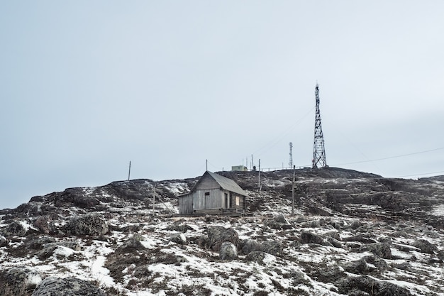 Cell towers in the snowcovered hills in tundra