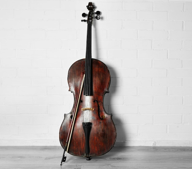 Cello on white brick wall surface