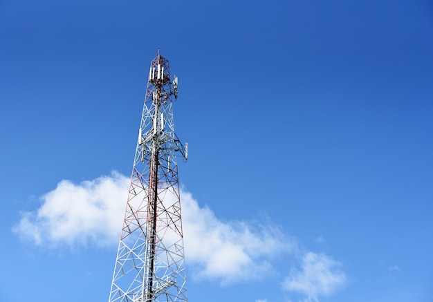 Cellphone telecommunication tower on sky background