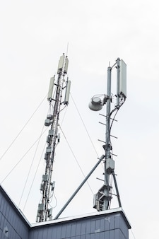 Cellular mobile phone antennas on a building roof. Technology  telecommunication GSM (5G,4