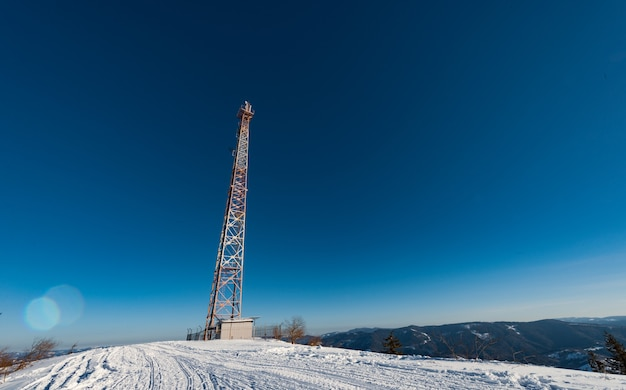 Cellular tower, winter nights against a blue starry sky