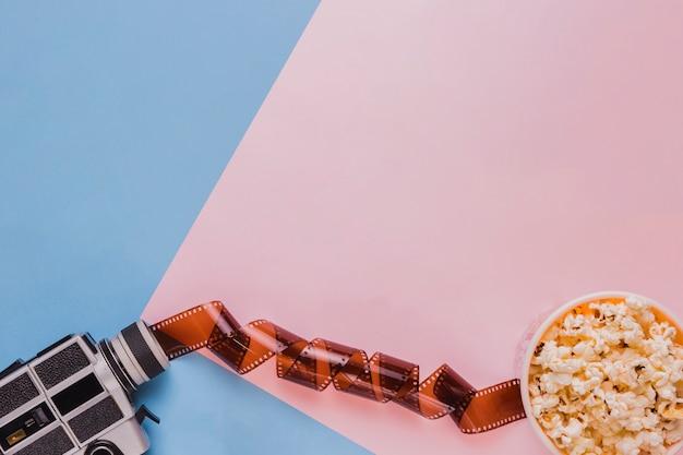 Целлулоид с попкорном и видеокамерой