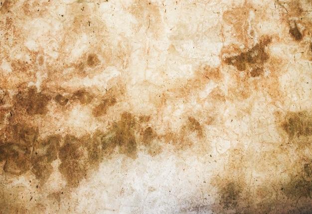 傷のあるセメントコンクリート。古い背景の壁。