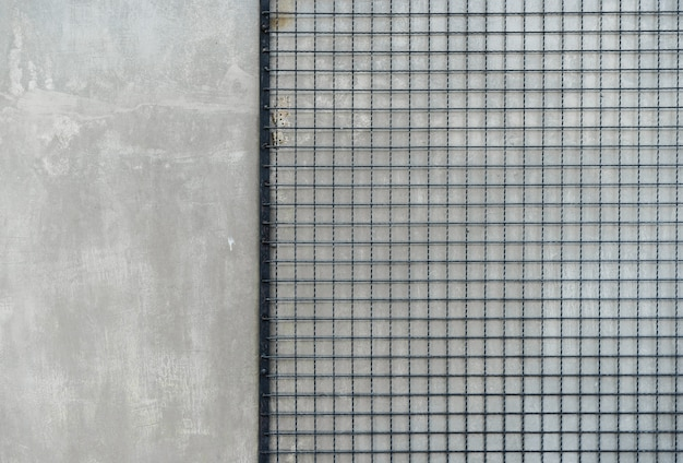 Cement floor background gray wall with steel chain link or wire mesh