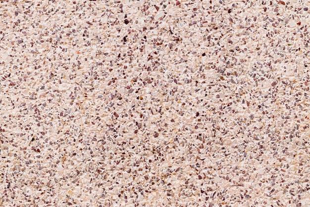 セメントは、小さな砂利の石の壁のテクスチャの背景を組み合わせたカラフルなテラッツォの床。