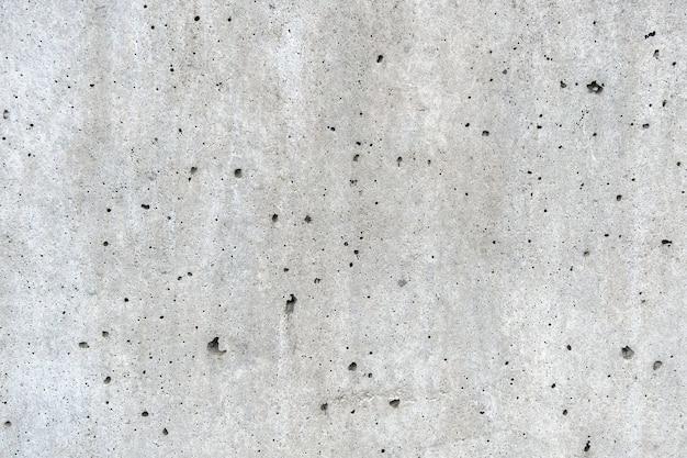 古い石の背景の灰色と黒の色と亀裂をセメントで固めます。