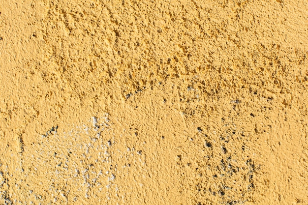 セメントまたは漆喰の壁と空の背景