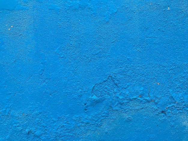 Cement wall the painted blue pastel has details.