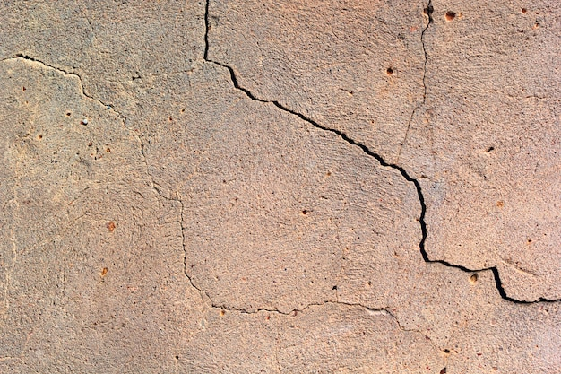 Cement wall with a crack texture