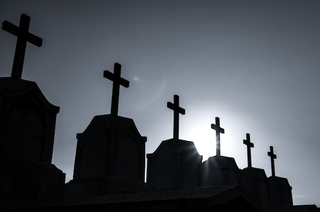 Cemetery or graveyard in the night with dark sky. headstone and cross tombstone cemetery. rest in peace concept. funeral concept. sadness, lament, and death. spooky and scary burial ground.