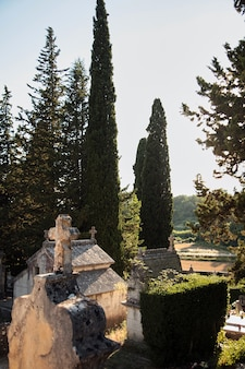 Cemetery with old stone crypts and crosses. european christian cemetery