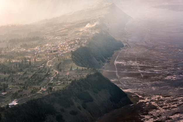 Cemoro lawang village on mountain cliff with foggy in sunrise