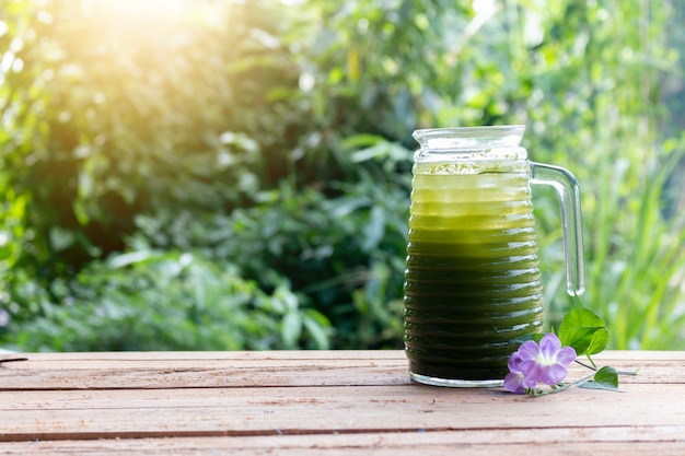 Centella asiatica iced drink water on wooden table