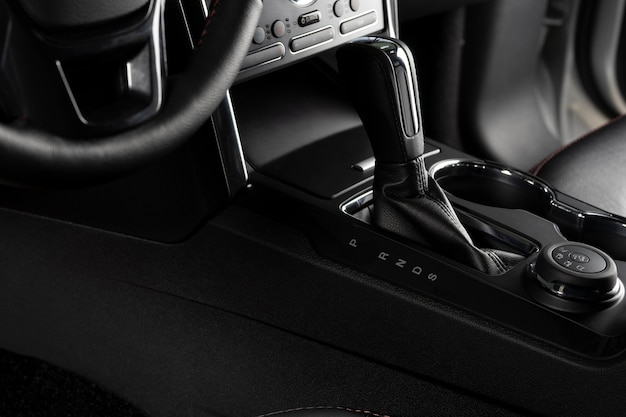 Center console inside a modern and luxurious car - automatic transmission close up
