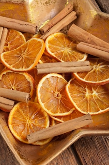 Centerpiece christmas with orange slices and cinnamon