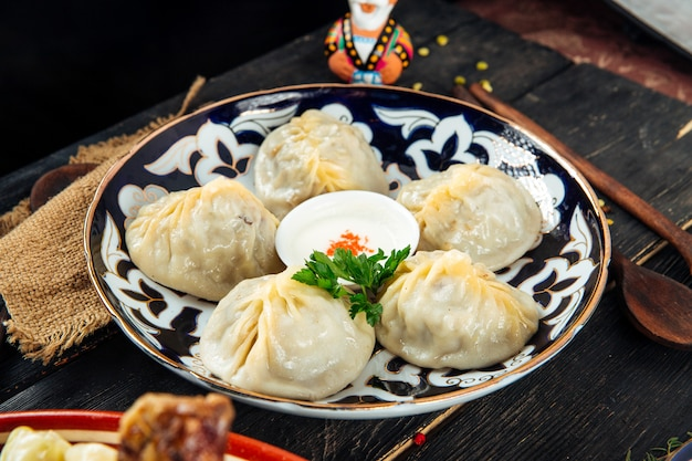 Central asian dumplings manti on traditional plate