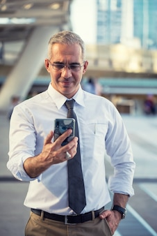 Ceo businessman on smart phone in city