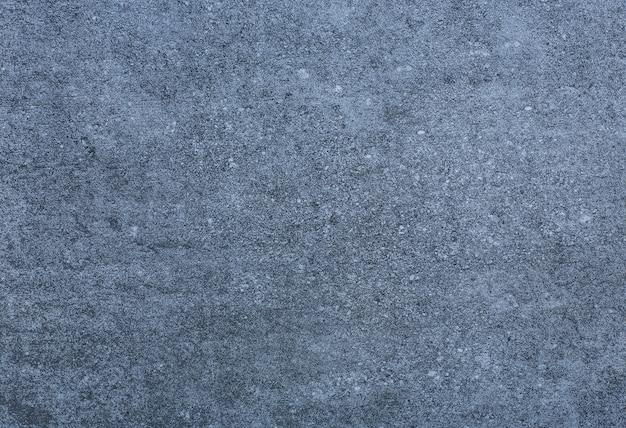 粗い抽象的な石の表面パターンを持つセラミックブルータイル