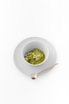 Ceramic bowl with matcha powder