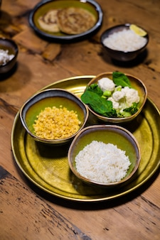 Ceramic bowls with jasmine rice, lentil and greens