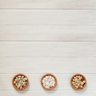 Ceramic bowls with nuts and seeds