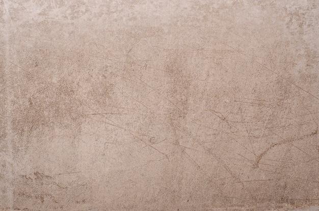Керамическая коричневая плитка с грубым абстрактным фоном поверхности камня