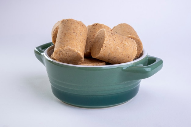 Ceramic container with sweets made from peanuts known in brazil as paã§oca.
